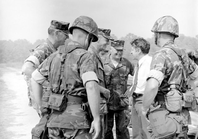 Secretary of Defense Caspar W. Weinberger talks with MGEN Alfred M. Gray Jr., commanding general, 2nd Marine Division. Joining in are LGEN Adolph G. Schwenk, commanding general, Fleet Marine Force Atlantic (FMFLANT), and MGEN Keith A. Smith, commanding general, Marine Air Wing, FMFLANT. Also looking on are two Marine colonels