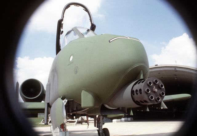A close-up front view of an A-10 Thunderbolt II aircraft with a GAU-8A Gattling gun