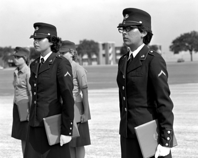 PFC A .L. Hernandez, left, and PFC T. D. Stinemetz are the honor graduates of their Series 8. Each is wearing the dress blue uniform and the rank of private first class, gifts for being honor graduates