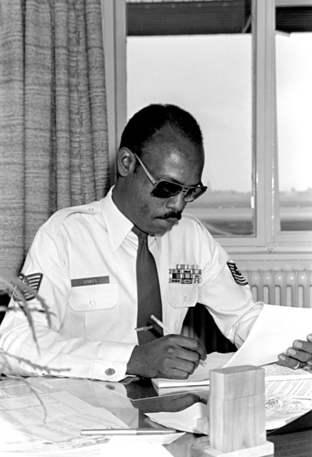 MSGT John Stokes, assistant chief, 7350th Air Base Group, proofreads a document before sending it to the public affairs division at Tempelhof Central Airport for final approval