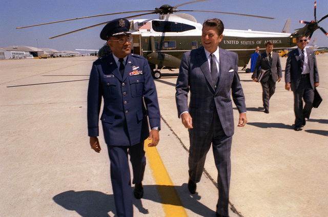 President Ronald Reagan is welcomed by BGEN Archer L. Durham upon his return to the United States