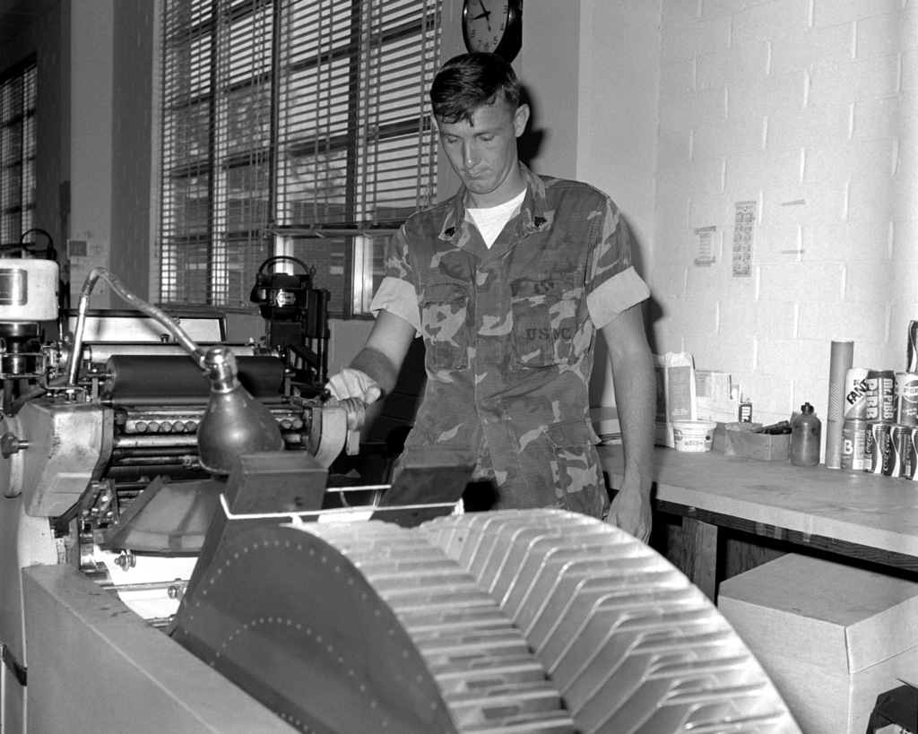 SGT James Taylor operates a Multilith 2850 Copy Center in the Reproduction Section. Taylor is in charge of the section which is a part of the Graphic Arts Branch of the Facilities and Services Division at the Marine Corps Logistics Base