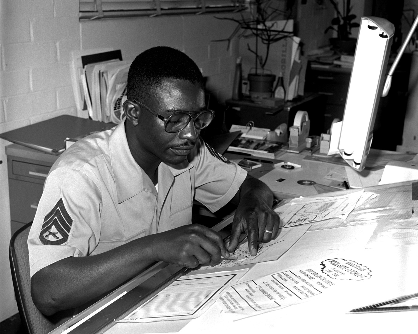 SSGT Moses McNeil is constructing a map of the housing area that is located aboard the Marine Corps Logistics Base. McNeil works for the Graphic Arts Branch of the Facilities and Services Division
