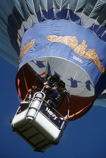A balloonist takes photographs as his comrade navigates a US Navy promotional balloon