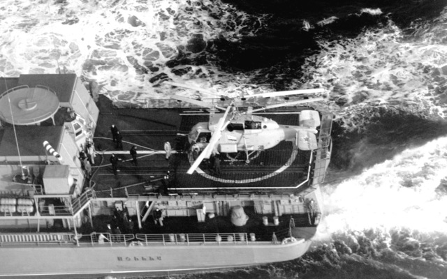 A high angle view of a Soviet Helix helicopter on the helicopter pad of the Soviet guided missile destroyer UDALOY during naval and amphibious exercises. The Kamov-built helicopter has anti-submarine capabilities