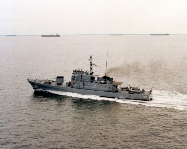An aerial port side view of the patrol combatant USS TACOMA (PG 92) underway