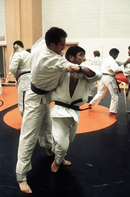 Judo coach MAJ Paul Maruyama (right) works out with a competitor during the 1981 National Sports Festival