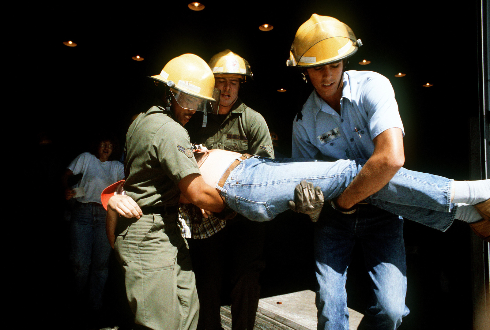 """Medical technicians carry a """"major aircraft accident victims"""" to one of the  groups of victims, arranged"""