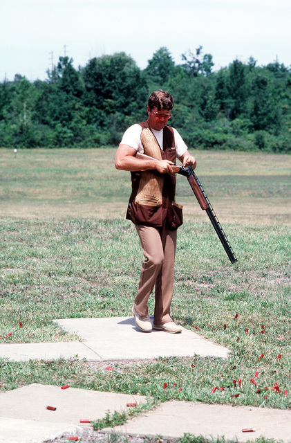World-class trapshooter MSGT Terry Howard reloads his shotgun before firing rounds at clay pigeon targets during the 1981 National Sports Festival