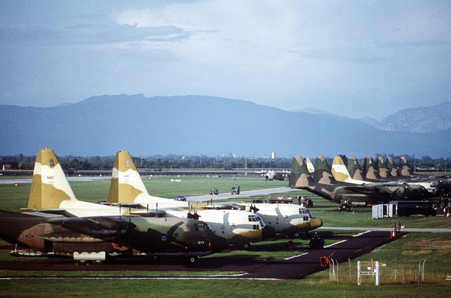 A view of C-130 Hercules aircraft parked in line. The aircraft are assigned to the 37th Tactical Airlift Wing (TAW), which is undergoing an operational readiness inspection by the 435th TAW