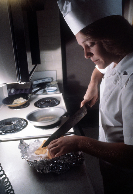 AMN Cindy S. Caraferno, from the 100th Services Squadron, prepares a high-protein breakfast for aircrew members