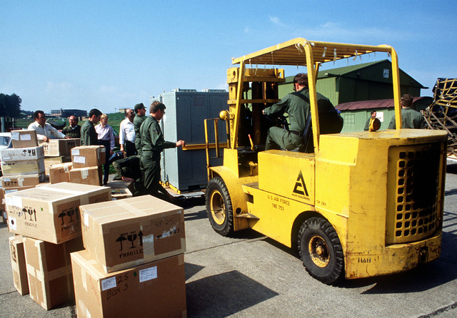 A medium-sized forklift is used by members of the 50th Component Repair Squadron, to separate the F-16 avionics test equipment