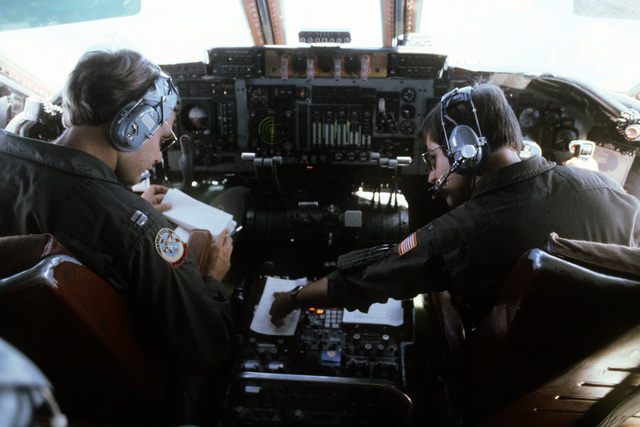 A flight crew from the 63rd Military Airlift Wing man the controls of a C-141 Starlifter aircraft as they approach Roosevelt Roads, P.R., for the start of Exercise Ocean Venture '81