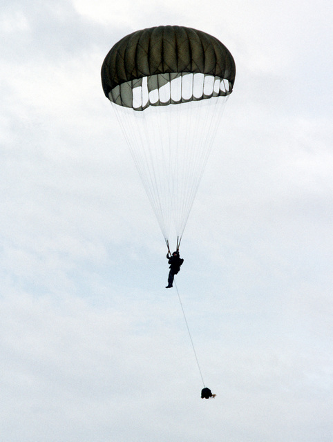A parachutist begins his descent after being dropped from a C-141 Starlifter aircraft as Exercise Ocean Venture '81 gets underway