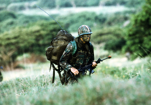 An Airborne Ranger from the 2nd Battalion, 75th Infantry, armed with an M-161A rifle, moves out toward a central gathering place after being dropped from a C-141 Starlifter aircraft, at the start of Exercise Ocean Venture '81