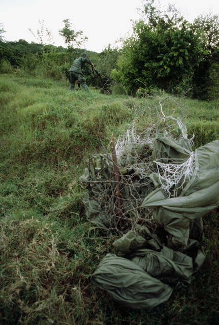An Airborne Ranger from the 2nd Battalion, 75th Infantry, untangles his gear from a barbed wire fence after being dropped from a C-141 Starlifter aircraft as Exercise Ocean Venture '81 gets underway