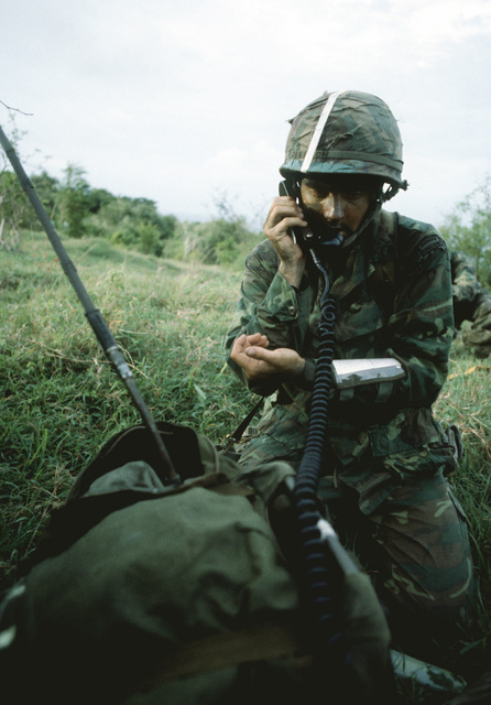 An Airborne Ranger from the 2nd Battalion, 75th Infantry, uses a field radio to report his and his comrades location after being dropped from a C-141 Starlifter aircraft as Exercise Ocean Venture '81 gets underway