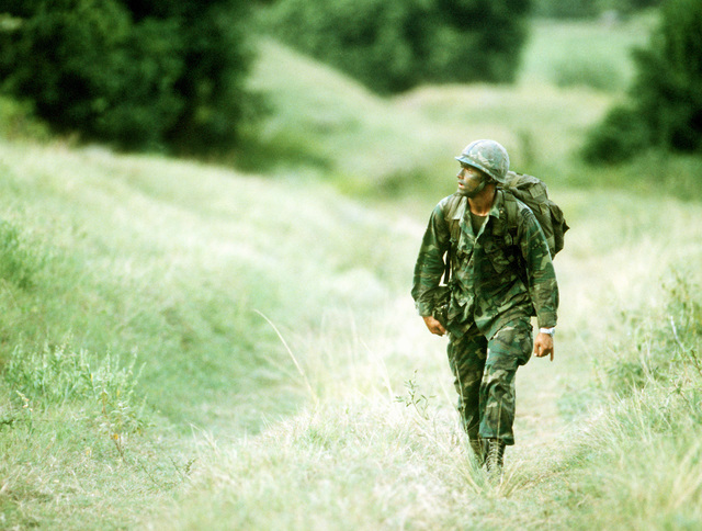 An Airborne Ranger from the 2nd Battalion, 75th Infantry, walks toward his unit after being dropped from a C-141 Starlifter aircraft as Exercise Ocean Venture '81 gets underway