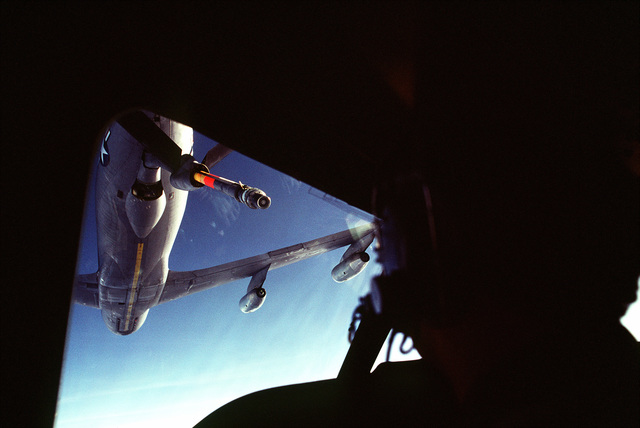 Bottom view of a KC-135 Stratotanker aircraft preparing to refuel a C-141 Starlifter aircraft during exercise Ocean Venture '81. Picture is taken from the interior of the Starlifter aircraft