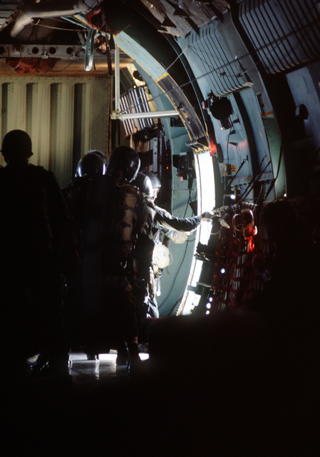 Crew members from the 63rd Military Airlift Wing help airborne Rangers from the 2nd Battalion, 75th Infantry, prepare to jump from a C-141B Starlifter aircraft at the start of Exercise Ocean Venture '81