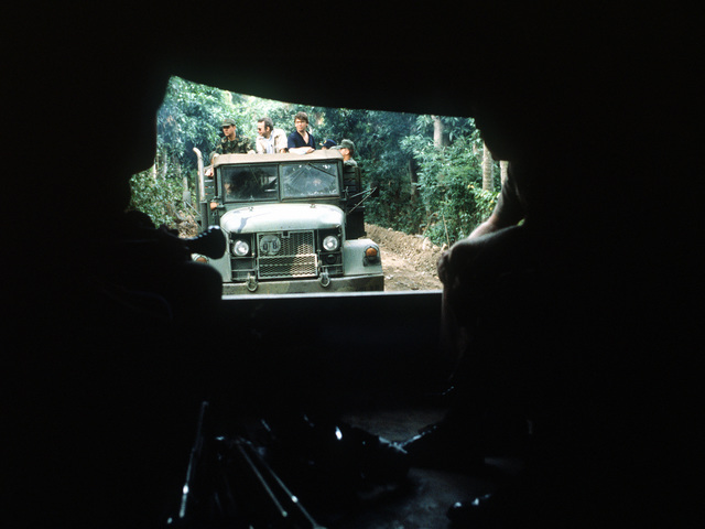 Members of the press are transported to the drop zone by truck as preparations are made for the start of Exercise Ocean Venture '81