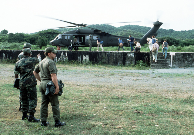 Members of the press prepare to board a UH-60 Blackhawk helicopter transportation to the drop zone as preparation are made for the start of Exercise Ocean Venture '81