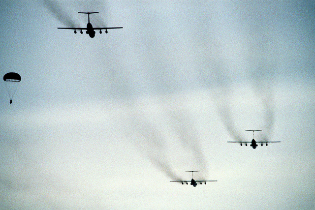 Three C-141 Starlifter aircraft make a pass over the drop zone to drop participants in Exercise Ocean Venture '81