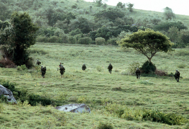 Troops from the Airborne Rangers, 2nd Battalion, 75th Infantry, move out into the field as Exercise Ocean Venture '81 gets underway