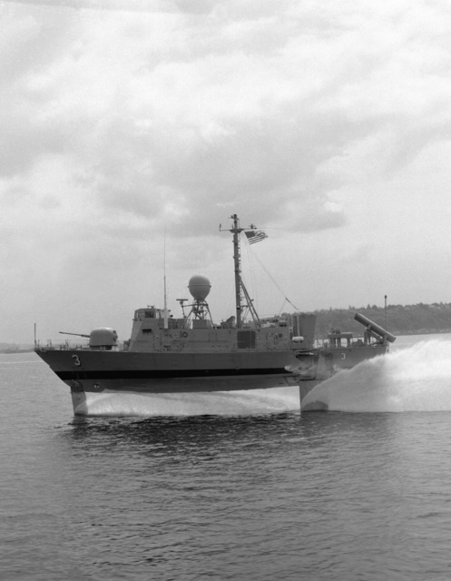 A port beam view of the patrol hydrofoil missile ship TAURUS (PHM-3) underway during high-speed pre-delivery tests
