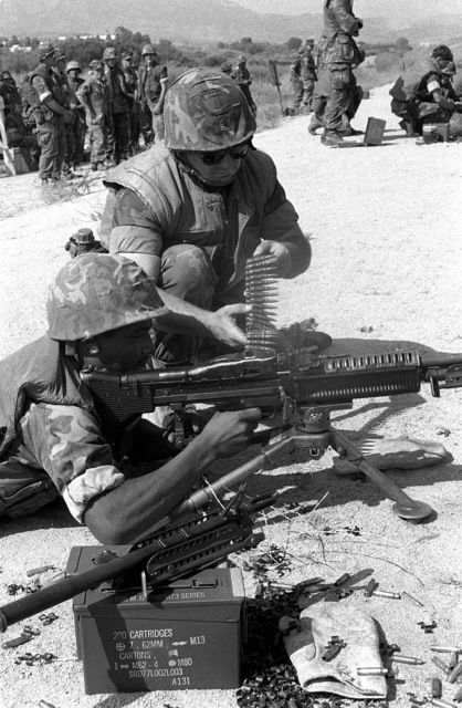 Marine reservists from Headquarters and Service Company, 1ST Battalion, 23rd Marines, fire the M-60A1 machine gun for familiarization