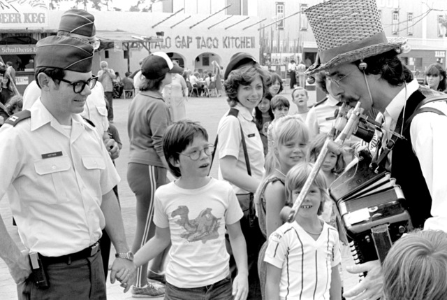 Air Force members of the 7350th Air Base Group escort children from the Haus Buckow Kinderheim Orphanage at the 22nd annual German-American Volksfest's Kinderheim Day