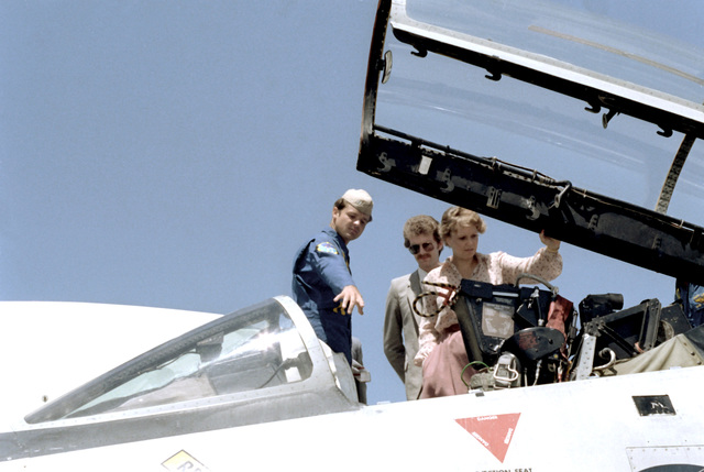 A pilot explains the cockpit of an aircraft to Maureen Reagan during her visit to the Pacific Missile Test Center to speak at an Equality Day luncheon. Ms. Reagan is the daughter of President Ronald Reagan