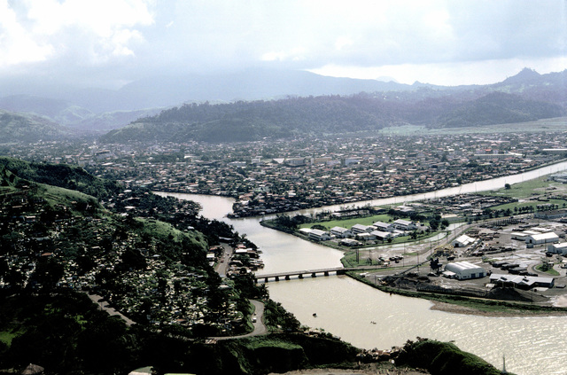 An aerial view of the city of Olongapo. The bridge that leads to the Naval Base, Subic Bay, is visible at bottom right