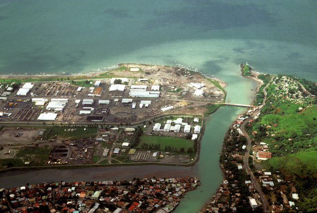 An aerial view, which includes part of the Naval Base, Subic Bay, left, part of the city of Olongapo and the bridge that is built over the canal to join the two communities