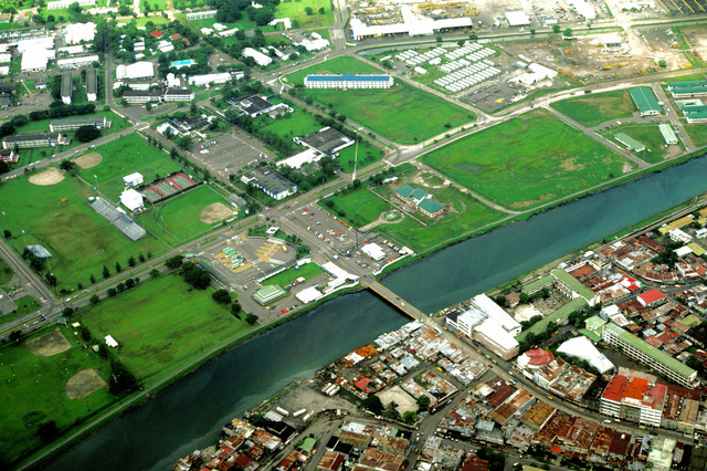 An aerial view which includes part of the Naval Base, Subic Bay, the city of Olongapo, bottom right, and the bridge that is built over the canal to join the two communities