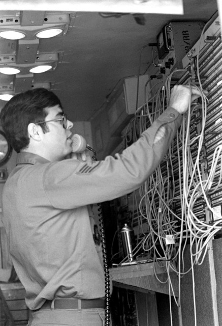SSGT Rick West of the 609th Tactical Control Squadron makes a telecommunications system check during Oksboel '81, a deployment exercise