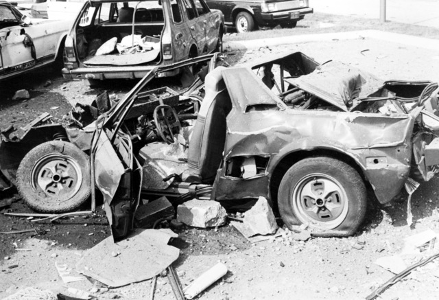 The remains of an automobile destroyed by bombs that also damaged the United States Air Force in Europe headquarters