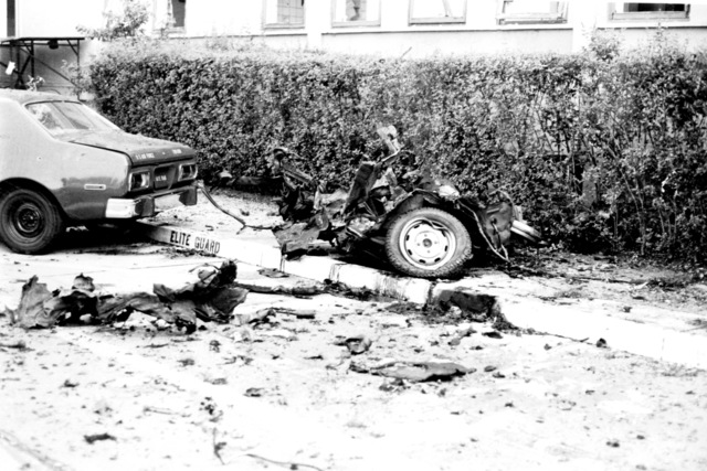The remains of an automobile destroyed by bombs that also damaged the United States Air Forces in Europe headquarters