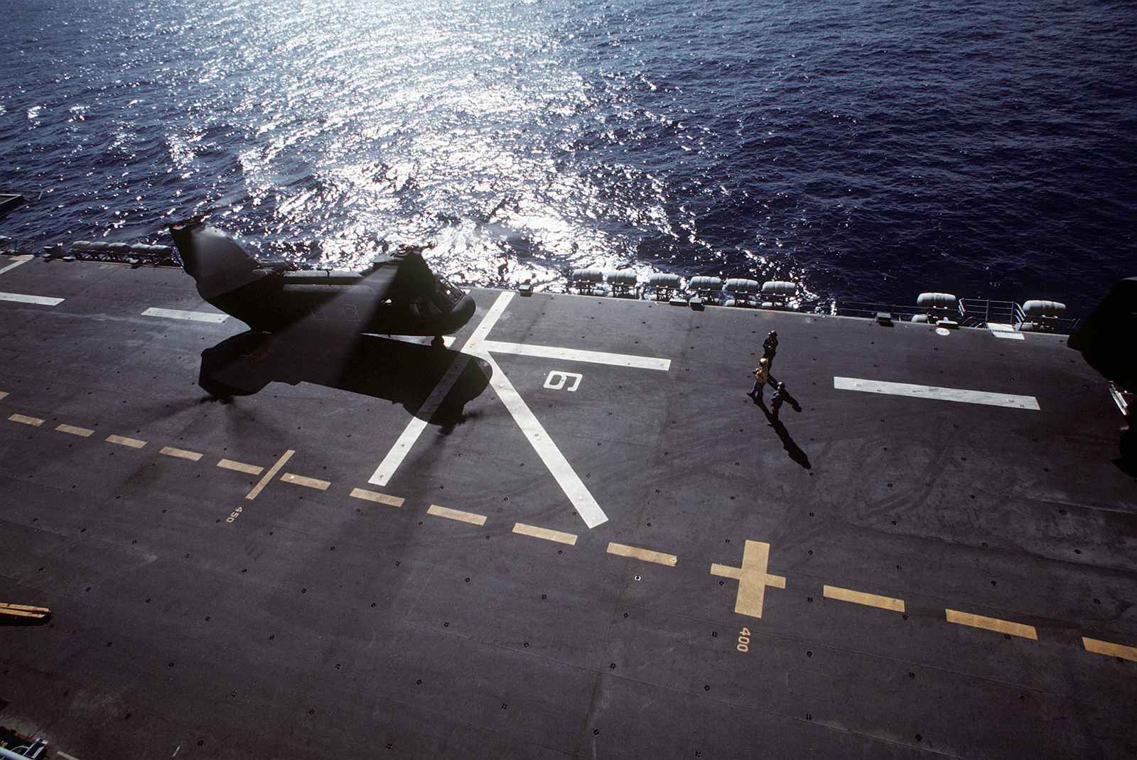 A CH-46 Sea Knight helicopter prepares for lift-off aboard the amphibious assault ship USS SAIPAN (LHA-2) during exercise Ocean Venture '81