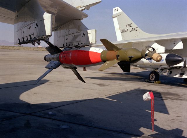 A close-up view of a Skipper II laser guided bomb mounted on the wing of an A-6 Intruder aircraft