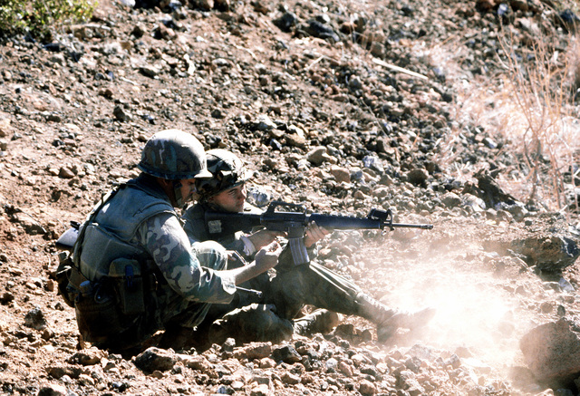 A Marine rifleman fires his M-16 rifle during his company's combat readiness evaluation at the Pakalula Training Area. The Marine is a member of Co. C, 1ST Bn., 3rd Marines, 3rd Mar. Div., Fleet Marine Force