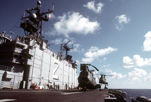 A port view of the island aboard the amphibious assault ship USS SAIPAN (LHA-2). CH-46 Sea Knight helicopters are on deck. The SAIPAN is taking part in exercise Ocean Venture '81