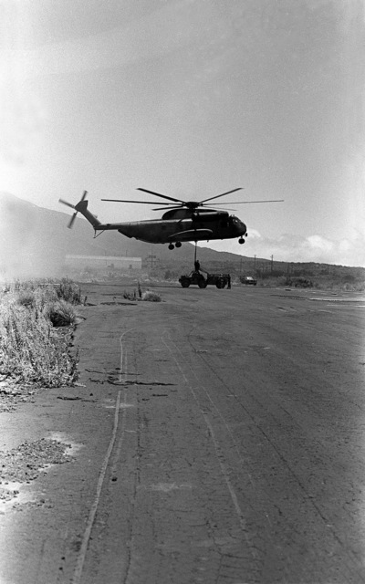 A Marine CH-53 Sea Stallion helicopter from Marine Heavy Helicopter Squadron 463 (HMH-63) carries a 105mm howitzer gun to Kilo Btry., 1ST Bn., 12th Marines. This activity is a part of the combat readiness evaluation at Pakalula Training Area
