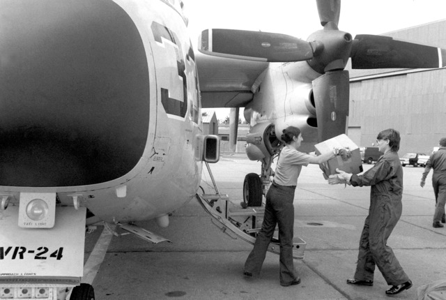Storekeeper 2nd Class Sue Wolf and CHIEF Aviation Storekeeper Patricia Raby unload a C-2A Greyhound aircraft, upon its return from participating in Operation Ocean Venture '81