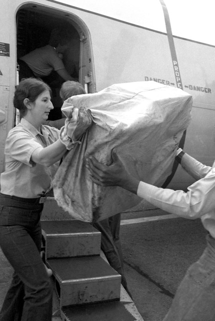 Storekeeper 2nd Class Sue Wolf unloads a C-2A Greyhound aircraft upon its return from participating in Operation Ocean Venture '81