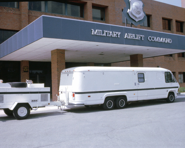 A view of the 15,000-pound Personnel Support for Contingency Operations (PERSCO) van with a 5,000-pound generator-carrying trailer in tow while parked at the entrance to the Military airlift Command (MAC) building. The van, which is the newest MAC addition, will be manned by two computer operators, a maintainer and a personnel systems manager. It will be maintained by the 1500th Computer Services Squadron