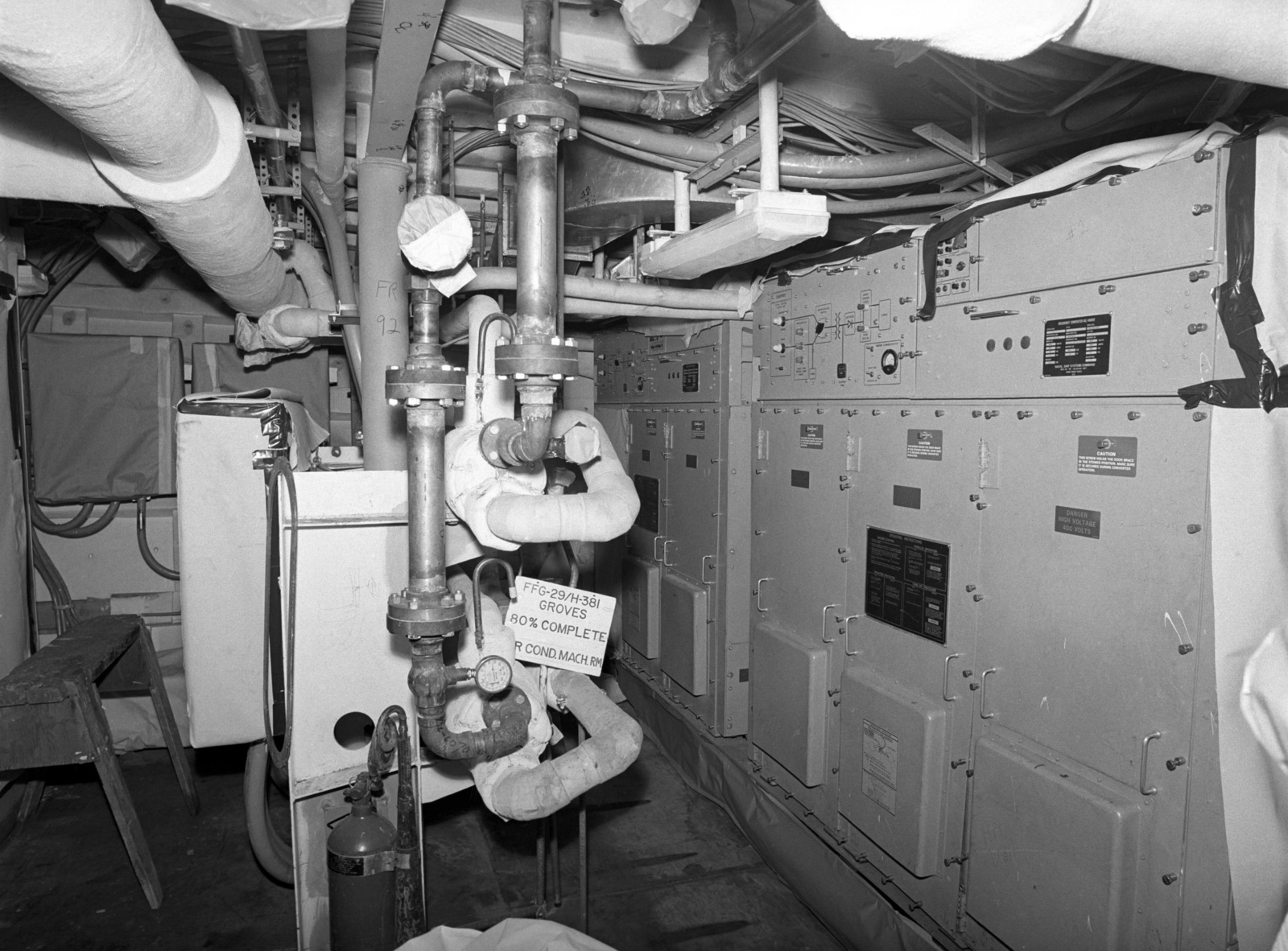 The air conditioning machinery room aboard the Oliver Hazard Perry class guided missile frigate USS STEPHEN W. GROVES (FFG 29) at 80 percent completion