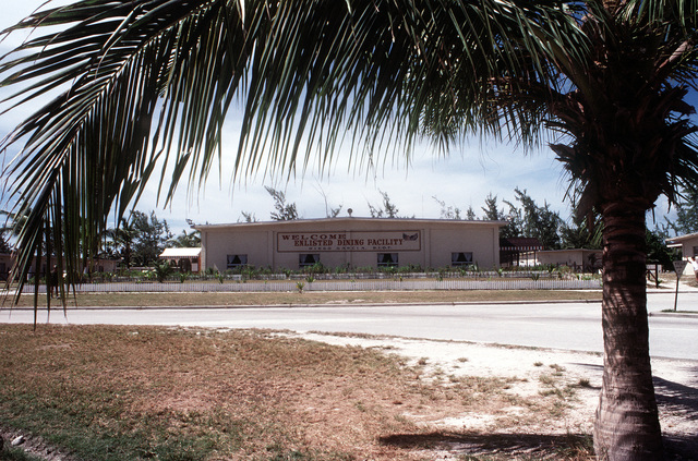 The enlisted dining facility with a palm tree nearby