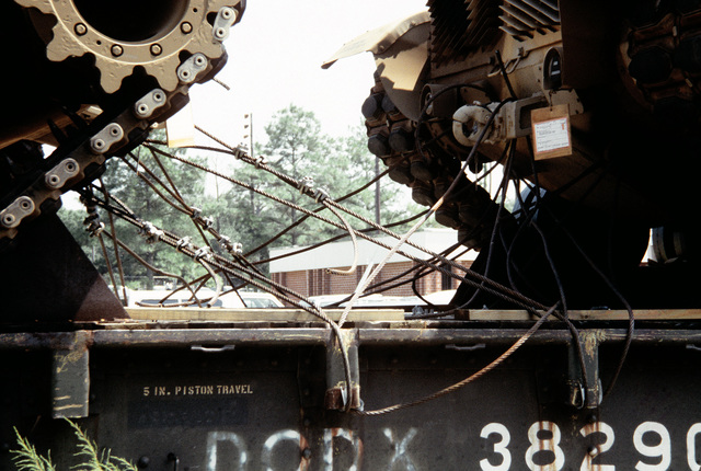 A close-up view of the cables that tie down Marine M-60A1 tanks onto railroad flatcars. The tanks are to be offloaded and placed aboard ships in support of the possible rapid deployment of a 12,000-troop Marine amphibious brigade operation. Marines of the 2nd Force Service Support Group are performing the work