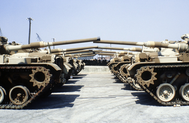 A view of Marine M-60A1 tanks parked in a staging area prior to being placed aboard a ship in support of a possible rapid deployment of a 12,000-troop amphibious brigade operation. Marines from the 2nd Force Service Support Group are performing the work
